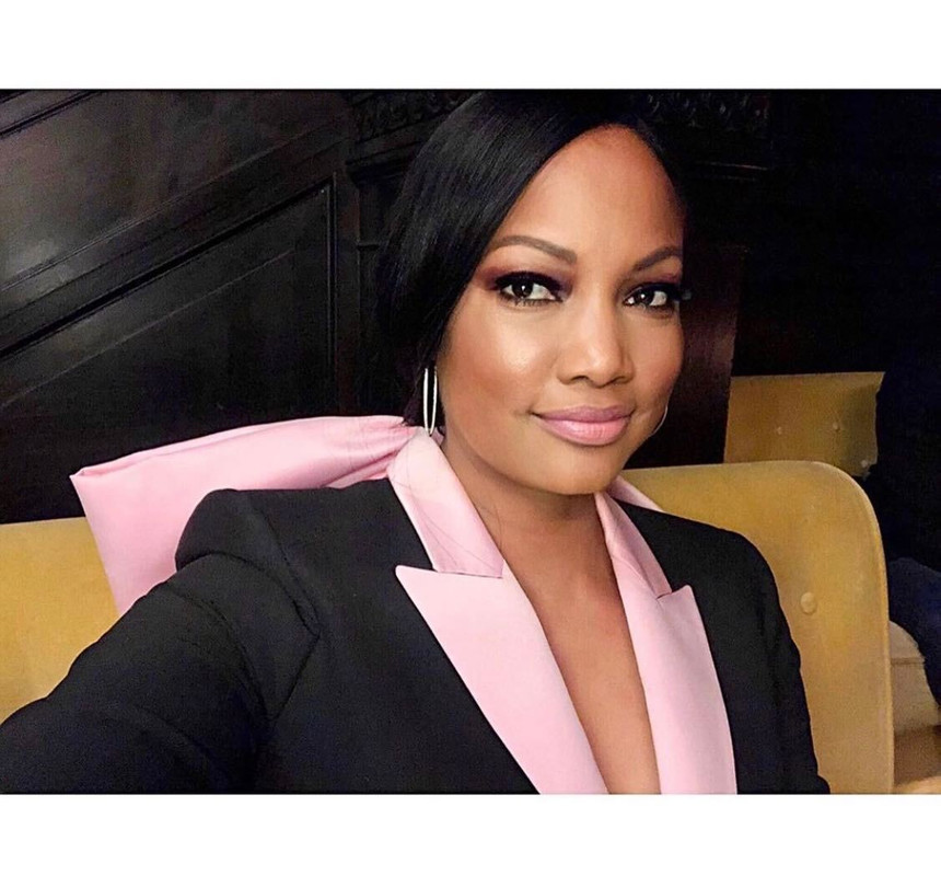 Garcelle Beauvais' Black and Pink Bow Blazer